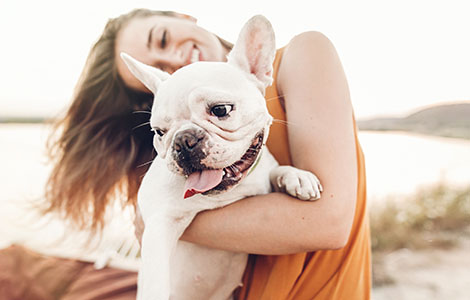 smiling-woman-holding-dog
