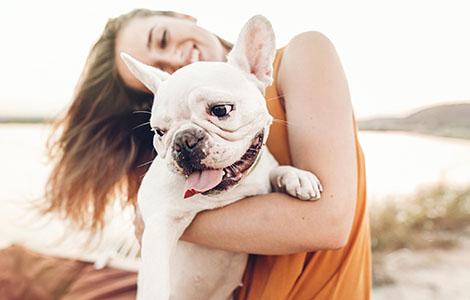 smiling-woman-holding-dog
